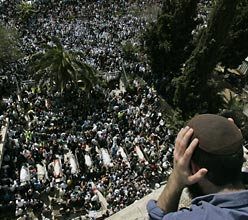 Thousands gathering on Fri. for funeral procession of 8 yeshiva students killed in shooting attack outside Mercaz Harav yeshiva in Jerusalem. (AP)