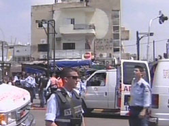 Rescue workers arriving at the scene of the Tel Aviv suicide attack on Monday. (Channel 1)
