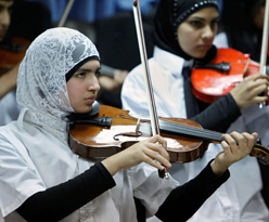 Members of a Palestinian youth orchestra from the West Bank performing for Holocaust survivors near Tel Aviv on Wednesday. (Reuters)